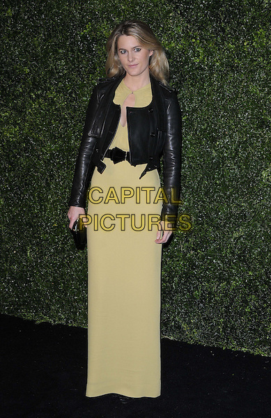 Lady Kinvara Balfour.The 58th London Evening Standard Theatre Awards in association with Burberry, Savoy Hotel, The Strand, London, England..November 25th, 2012.full length  black  dress leather jacket  yellow clutch bag.CAP/CAN.©Can Nguyen/Capital Pictures.