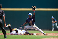 Charlotte Stone Crabs shortstop Vidal Brujan (2) catches a throw down as Lucas Tancas (27) dives back to second base during a Florida State League game against the Bradenton Marauders on April 10, 2019 at LECOM Park in Bradenton, Florida.  Bradenton defeated Charlotte 2-1.  (Mike Janes/Four Seam Images)