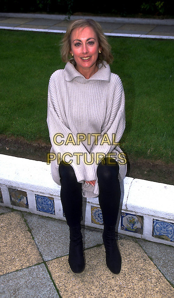 PAULA WILCOX.SALES REF: 3181.INTERNAL REF: 0636/67/HT.Ref: HT.full length sitting grey gray jumper.www.capitalpictures.com.sales@capitalpictures.com.©Hugh Thompson/Capital Pictures