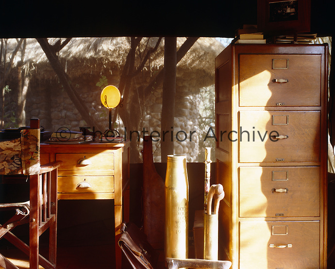 A study area in one corner of this tent comprises an English oak desk and a filing cabinet from the 1930s