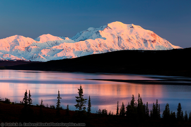 Mt Denali and Wonder Lake with pink alpenglow light reflecting in the lake, Denali National Park, Interior, Alaska
