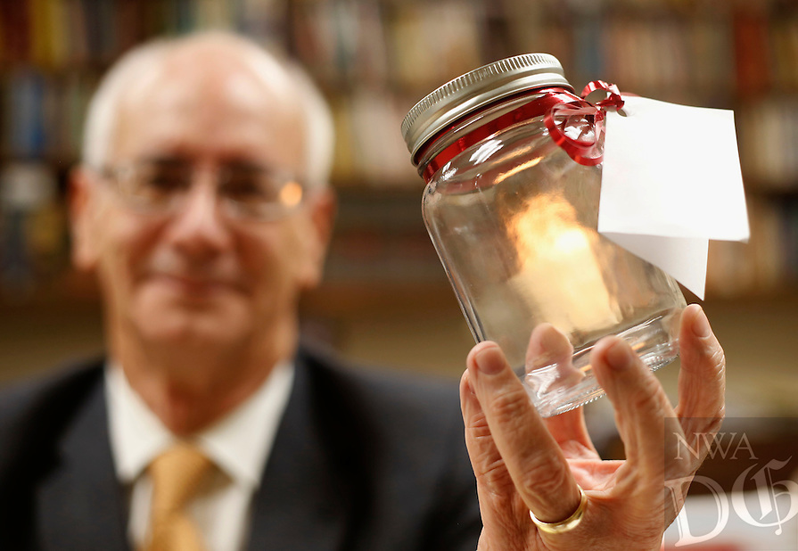 NWA Democrat-Gazette/DAVID GOTTSCHALK  Reverend Kurt Bogan, with First United Methodist Church in Bentonville displays a bottle Tuesday, December 1, 2015, that he received from a parishioner as a gift that symbolizes peace at Christmas time.