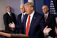 United States President Donald J. Trump speaks during a press briefing on the Coronavirus COVID-19 pandemic with members of the Coronavirus Task Force at the White House in Washington on March 19, 2020.  Immediately to the left of the President is US Vice President Mike Pence; and immediately to the right of the President is Stephen Hahn, Commissioner, US Food and Drug Administration (FDA).<br /> Credit: Yuri Gripas / Pool via CNP/AdMedia