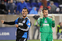 Chris Wondolowski (8) qnd goalkeeper Jon Busch (18) of the San Jose Earthquakes celebrate at the end of the game. The San Jose Earthquakes defeated the New York Red Bulls 3-1, (3-2) on aggregate during the 2nd leg of the Major League Soccer (MLS) Eastern Conference Semifinals at Red Bull Arena in Harrison, NJ, on November 04, 2010.