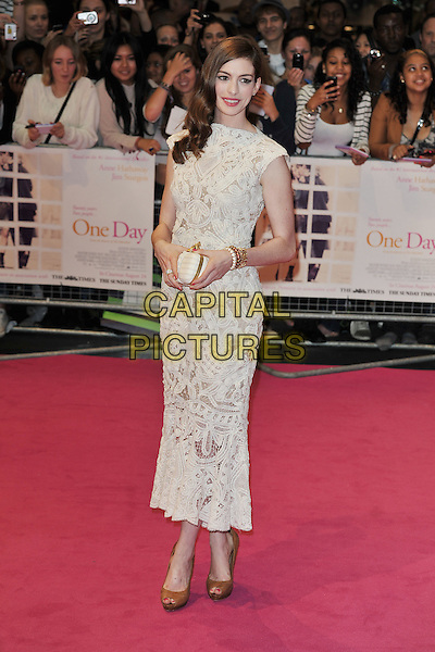 "Anne Hathaway (in Alexander McQueen).""One Day"" UK premiere, Vue Westfield cinema, Westfield Shopping Centre, London, England..August 23rd, 2011.full length white sleeveless crochet lace dress brown hazelnut whipstitch peep toe shoes white jaw skull clutch bag embroidered.CAP/MAR.© Martin Harris/Capital Pictures."