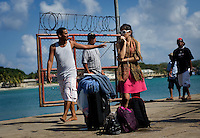 Locals and visitors to Big Corn Island mix and move about at the dock off the coast of Nicaragua in April 2009.