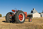 Early-mid 1950s McCormik Farmall Super M tractor, warehouse and grain elevator