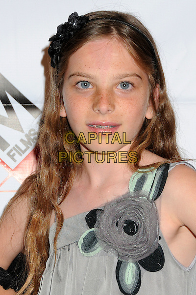 "ISABELLA HEWITT .""Blood Out"" Los Angeles Premiere held at the DGA, West Hollywood, California, USA, 25th April 2011..portrait headshot grey gray flower corsage .CAP/ADM/BP.©Byron Purvis/AdMedia/Capital Pictures."