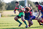 Opeta Lafotasi bursts throught the midfield tackle of Samuela Alatini. Counties Manukau Premier Club Rugby game between Waiuku & Ardmore Marist played at Waiuku on Saturday 20th June, 2009. Waiuku won the game 28 - 25.