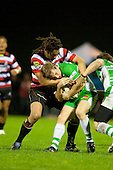 Hadleigh Parkes gets wrapped up by Tana Umaga. ITM Cup rugby game between Counties Manukau and Manawatu played at Bayer Growers Stadium on Saturday August 21st 2010..Counties Manukau won 35 - 14 after leading 14 - 7 at halftime.