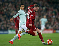 Liverpool's Jordan Henderson passes under pressure from Bayern Munich's Thiago Alcantara<br /> <br /> Photographer Rich Linley/CameraSport<br /> <br /> UEFA Champions League Round of 16 First Leg - Liverpool and Bayern Munich - Tuesday 19th February 2019 - Anfield - Liverpool<br />  <br /> World Copyright © 2018 CameraSport. All rights reserved. 43 Linden Ave. Countesthorpe. Leicester. England. LE8 5PG - Tel: +44 (0) 116 277 4147 - admin@camerasport.com - www.camerasport.com