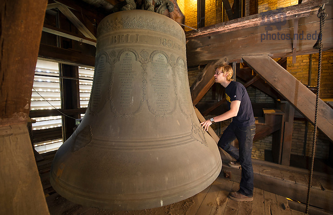 Sept. 8, 2014; Graduate student Benjamin Sunderlin examines the carillon church bells in the bell tower of the Basilica of the Sacred Heart. (Photo by Barbara Johnston/University of Notre Dame)