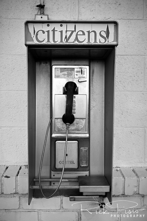 Pay phone outside of an abandoned gas station in Holbrook, Arizona.