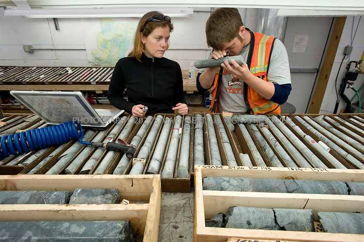 8/4/2008--Iliamna, AK, USA..Geologists Cassady Harraden, 23 (left) and Brian McNulty, 24 (right) working at Pebble Ltd sorting and analyzing drill cores. The Pebble Mine site is currently being drilled to map deposits of ore for possible extraction. The mine contains large deposits of copper, gold, and molybdenum and is in the Bristol Bay region of Southwest Alaska, near Lake Iliamna. The proposal to build a large mine is controversial and opponents say it threatens nearby wild salmon runs from Bristol Bay into the nearby watersheds. .The mine is being explored by Pebble Ltd Partnership, a joint venture of  Northern Dynasty Partnership and Anglo American US LLC. The mine  would probably include an open pit and large dams to contain waste. Bristol Bay is home to some of the largest runs of salmon in the world and the world's largest sockeye salmon fishery. It's also a popular sport fishing area, and subsistence fishing is important to the region's native communities...©2008 Stuart Isett. All rights reserved.