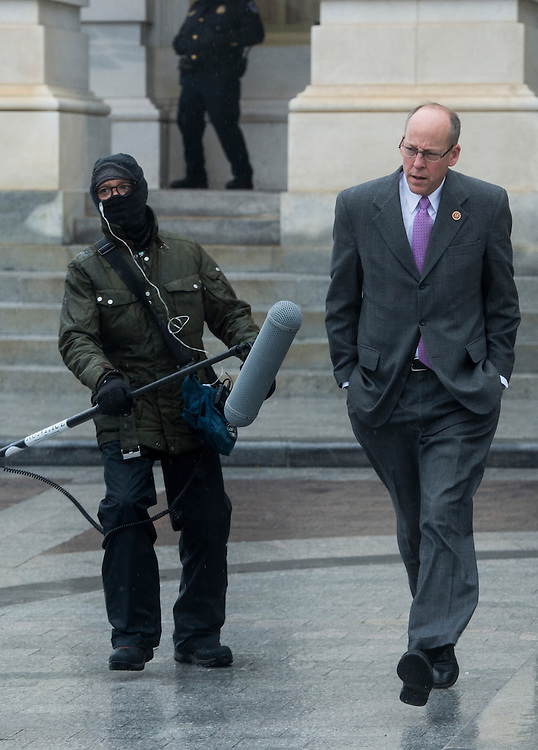 UNITED STATES - MARCH 6: Rep. Greg Walden, R-Ore., leaves the Capitol following the last vote of the week in the House of Representatives on Wednesday, March 6, 2013. Congress adjourned early due to a snow storm in the mid-Atlantic region. When asked about the weather by a television news crew, Walden wondered why they shut the government down for rain. (Photo By Bill Clark/CQ Roll Call)