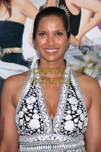 PADMA LAKSHMI.Attending the World Film Premiere of 'Sex and the City 2' at Radio City Music Hall in New York City, New York, NY, USA. .May 24th, 2010.SATC half length black white pattern halterneck dress floral print cleavage dangling gold earrings .CAP/LNC/TOM.©TOM/LNC/Capital Pictures.