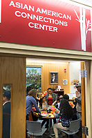 People gather for a Lunar New Year celebration at Middlesex Community College's Asian American Connections Center on Thurs., Feb. 15, 2018. The Asian American Connections Center was established at the school using a federal grant in 2016 and serves as a focal point for the Asian community at the school, predominantly Cambodian, to gather, socialize, study, and otherwise take part in student life.