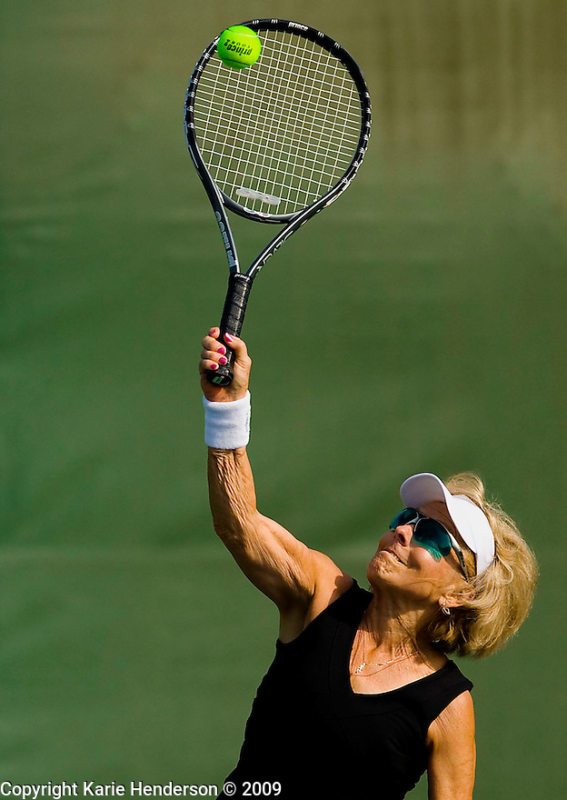 Ellie Trimble, 74, MO, hits the ball against Irma Demarzo, during the women's 70-74 tennis bracket during the Senior Games 2009, at Stanford University's Taube Tennis Center, in Palo Alto, Calif., on Tuesday, August 11, 2009.