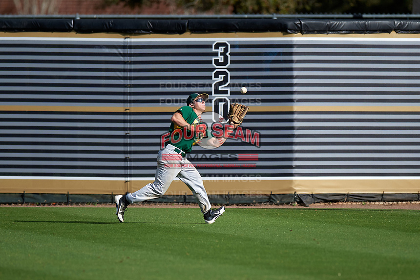 Siena Saints right fielder Carlos Tapia (29) catches a fly ball during a game against the UCF Knights on February 21, 2016 at Jay Bergman Field in Orlando, Florida.  UCF defeated Siena 11-2.  (Mike Janes/Four Seam Images)