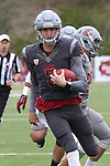 Tyler Hilinski scrambles for extra yards during the annual Washington State Cougar spring game, the Crimson and Gray game, at Joe Albi Stadium in Spokane, Washington, on April 23, 2016.