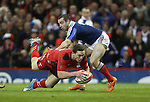 Center George North dives over to score the first try of the match for Wales despite the efforts of French scrum half Jean-Marc Doussain to stop him.<br /> RBS 6 Nations 2014<br /> Wales v France<br /> Millennium Stadium<br /> 21.02.14<br /> <br /> &copy;Steve Pope-SPORTINGWALES