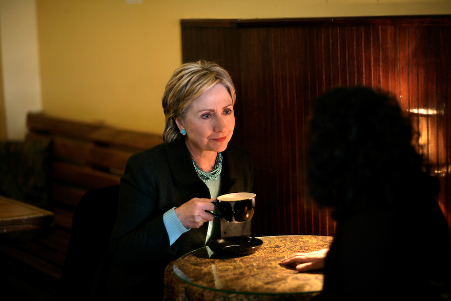 U.S. Senator and Democratic presidential hopeful Hillary Rodham Clinton (D-NY) (R) drinks a chai at Brewbakers coffee shop in Keene, New Hampshire February 11, 2007.<br /> Photo by Brooks Kraft/Corbis