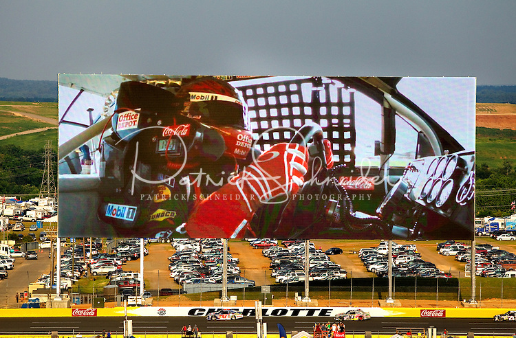 The Charlotte Motor Speedway in Concord NC unveiled the world's largest HDTV screen May 2011 at the NASCAR Sprint All-Star Race Coca-Cola 600. The HD video board, made by Panasonic, is 200 feet wide and 80 feet tall and approximately 30 percent larger than the much-lauded video board at Texas' Cowboys Stadium.