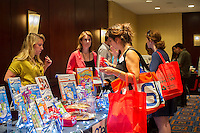 Attendees at the 2013 Holiday Gift<br /> Guide Show held in midtown in New York on Wednesday, June 19, 2013.  (&copy; Frances M. Roberts)