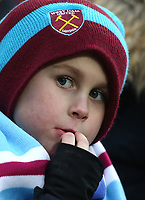 A young West Ham fan<br /> <br /> Photographer Rob Newell/CameraSport<br /> <br /> The Premier League - West Ham United v Watford - Saturday 10th February 2018 - London Stadium - London<br /> <br /> World Copyright &copy; 2018 CameraSport. All rights reserved. 43 Linden Ave. Countesthorpe. Leicester. England. LE8 5PG - Tel: +44 (0) 116 277 4147 - admin@camerasport.com - www.camerasport.com