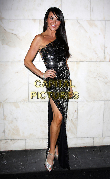 LIZZIE CUNDY .Attending the MacMillan Cancer Support Charity event, Hotel Intercontinental, London, England, UK, .November 19th 2009..full length one shoulder black sequined sequin dress hand on hip fringe gold peep toe ankle strap beaded jewelled shoes platform silver embellished waist belt brooch diamante thigh leg side split slit long maxi .CAP/AH.©Adam Houghton/Capital Pictures.