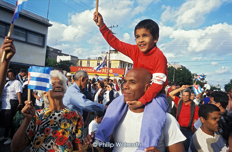 "100,000 Cubans demonstrate in Havana for the return of Elian Gonzalez from the USA. The 6 year-old boy survived a shipwreck in which his mother and stepfather drowned and, according to the Cuban government, was used as a ""political football"" by right-wing Cuban groups based in Miami."