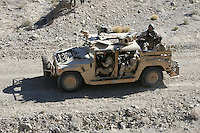 """HMMWV or """"Humvee"""" manufactured by AM General.  Gun-truck version used by USAF special operations tactical controllers (JTACs).  Weapons include M2 and M240 machineguns, no armor, and a bad attitude.  Common variants include M998, M1114, M707, and many others.  Credit Hans Halberstadt.  Reproduction requires license."""