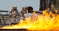 NWA Democrat-Gazette/BEN GOFF @NWABENGOFF<br /> Northwest Arkansas Regional Airport firefighters extinguish a blaze on a simulated aircraft Friday, March, 23, 2018, during disaster training at Northwest Arkansas Regional Airport in Highfill. Multiple Northwest Arkansas emergency agencies participated in the training, with volunteers acting as victims to create a simulated aircraft emergency. The airport holds the large-scale, multi-agency drills every three years according to Gilbert Neil, the airport's public safety director.