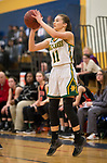 WATERBURY,  CT-021819JS22-  Holy Cross' Hanna Brown (11) hits a three-point shot during their NVL semi-final game against Watertown Monday at Kennedy High School in Waterbury. Brown scored 12 in their 48-32 win over the Indians. <br /> Jim Shannon Republican American