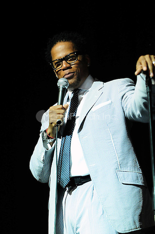 MIAMI, FL - APRIL 23: Comedian D.L. Hughley performs during The Barber Shop Comedy Tour Presented by Peoples Choice Entertainment at James L. Knight Center on April 23, 2011 in Miami, Florida. (photo by MPI10/MediaPunch Inc.)