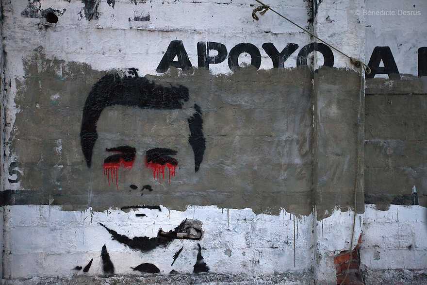 Graffiti of Mexico's President Enrique Pena Nieto) paint in the streets of Mexico City. Tens of thousands protest march in support of the 43 missing Ayotzinapa's students, on a day normally reserved for the celebration of Mexico's 1910-17 Revolution, in Mexico City, Mexico on November 20, 2014. Parents of the 43 missing students still do not believe the official line that the young men are all dead. Criticism of the government has intensified in Mexico and the country has been convulsed by protests. Many are demanding justice and that the search for the 43 missing students continue until there is concrete evidence to the contrary. Mexico officially lists more than 20 thousand people as having gone missing since the start of the country's drug war in 2006, and the search for the missing students has turned up other, unrelated mass graves.(Photo by BénédicteDesrus)