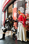 (L to R) Aka Samurai and Kuro Shogun pose for the cameras during the new Burger King's red burgers launching event on July 3, 2015, in Tokyo, Japan. The two new burgers ''AKA SAMURAI CHICKEN'' and ''AKA SAMURAI BEEF'' use red buns and red cheese, colored by tomato powder and spicy red sauce and will be sold at Japanese branches until August. The AKA SAMURAI CHICKEN costs 540 JPY (4.39 USD) and the AKA SAMURAI BEEF costs at 690 JPY (5.61 USD). As a part of the promotion Burger King plans to launch two new black burgers on August 21st. (Photo by Rodrigo Reyes Marin/AFLO)