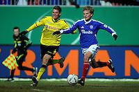 FUSSBALL   DFB POKAL   SAISON 2011/2012   VIERTELFINALE Holstein Kiel - Borussia Dortmund                          07.02.2012 Lukasz Piszczek (li, Borussia Dortmund) gegen Dan-Patrick Poggenberg (re, Kiel)