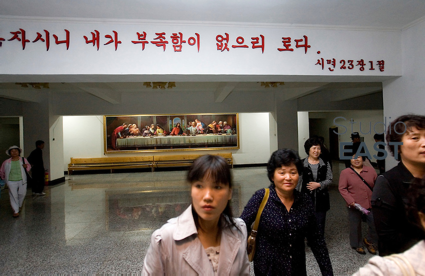 Chinese Koreans exit mass under a quotation from the Bible written in Korean, in the Chinese Christian church of Yanji, Jilin province, China, on May 9, 2009. Photo by Lucas Schifres/Pictobank