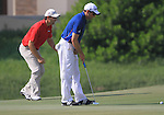 Sergio Garcia and Padraig Harrington line up their putts on the 14th green during the Final Day of the Dubai World Championship, Earth Course, Jumeirah Golf Estates, Dubai, 28th November 2010..(Picture Eoin Clarke/www.golffile.ie)