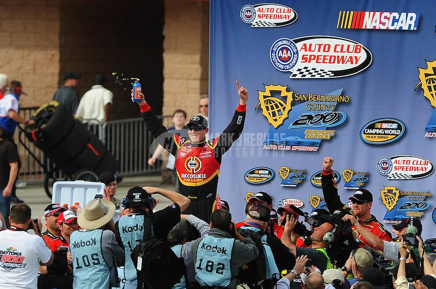 Feb 21, 2009; Fontana, CA, USA; NASCAR Camping World Truck Series driver Kyle Busch celebrates after winning the San Bernardino County 200 at Auto Club Speedway. Mandatory Credit: Mark J. Rebilas-