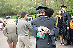 Engineering graduate Azam Al-Rushadi is congratulated by family following spring commencement. Photo by Ben Siegel