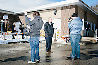 A Huffington Post video crew interviews former Virginia governor and Republican presidential candidate Jim Gilmore as he greets people outside the polling station for Manchester's Ward 2 at Hillside Middle School in Manchester, New Hampshire, on the day of primary voting, Feb. 9, 2016. Gilmore finished in last place among major Republican candidates still in the race with a total of 150 votes.