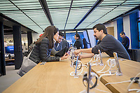 A worker explains the Galaxy S7 smartphone to visitors in the Samsung 837 showroom in the Meatpacking District in New York, seen on Saturday, February 27, 2016. The showroom in the trendy Meatpacking district does no sales but is a showcase for Samsung products. (© Richard B. Levine)