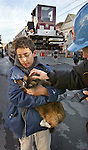 "Oscar Azucena (13) comes to his cats (""Dirty Feet"") rescue after being uprooted from his home at on Florida Street near 22nd Street in SF after a early morning fire destroyed a three floor structure."