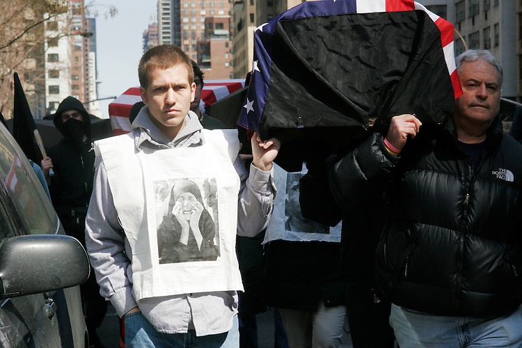 """Anti-war group """"One Thousand Coffins"""" marches in New York City on March 19, 2005, part of a day of protest in the city against the continuing wars in Iraq and Afghanistan."""