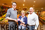 Breda Talbot of Caherleaheen Tralee winner of the Garveys Supervalu/Kerry's Eye competition pictured in store in Rock St with John Wrenn (Garveys Supervalu) and Brendan Kennelly (Kerry's Eye) on Tuesday.