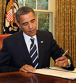 United States President Barack Obama signs the Southwest Border Security Bill in the Oval Office of the White House, Washington, DC Friday, August 13, 2010..Credit: Martin H. Simon - Pool via CNP