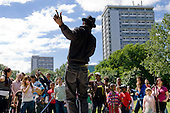 A local rapper performs at Westbourne Community Festival, Westbourne Green, close to Warwick Estate.