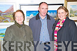 Pictured at the art sale and auction in Kate Kearneys Cottage, Beaufort on Saturday night in aid of the Friends of Sudan were Sheila Kissane with Paul and Christina Farrell.